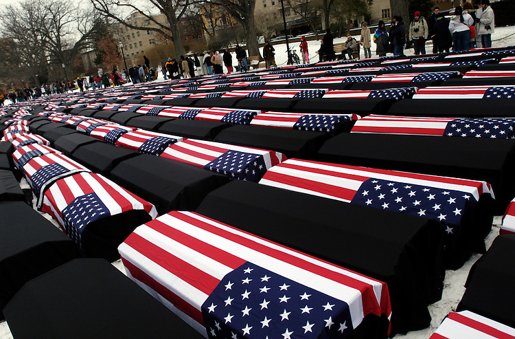 Protesters laid out mock solider coffins against the 2005 Presidential Inauguration during a rally at Malcolm X park.