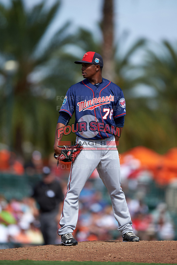 Minnesota Twins relief pitcher Randy Rosario (76) looks in for the sign during a Spring Training game against the Baltimore Orioles on March 7, 2016 at Ed Smith Stadium in Sarasota, Florida.  Minnesota defeated Baltimore 3-0.  (Mike Janes/Four Seam Images)