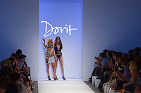 Designer Dorit Lemel and Model walk runway at Dorit Swimwear Show during Mercedes Benz IMG Fashion Swim Week 2013 at The Raleigh Hotel, Miami Beach, FL on July 23, 2012