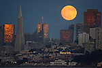 The June full moon decorated San Francisco skyline Friday evening while the sunset reflected golden glow off tall buildings. .