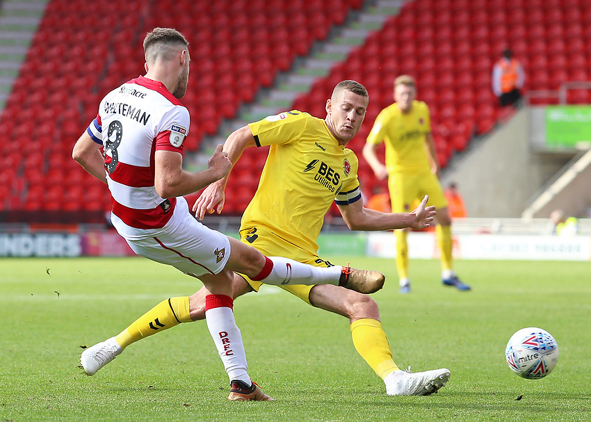 Fleetwood Town's Paul Coutts chases down Doncaster Rovers' Ben Whiteman<br /> <br /> Photographer David Shipman/CameraSport<br /> <br /> The EFL Sky Bet League One - Doncaster Rovers v Fleetwood Town - Saturday 17th August 2019  - Keepmoat Stadium - Doncaster<br /> <br /> World Copyright © 2019 CameraSport. All rights reserved. 43 Linden Ave. Countesthorpe. Leicester. England. LE8 5PG - Tel: +44 (0) 116 277 4147 - admin@camerasport.com - www.camerasport.com