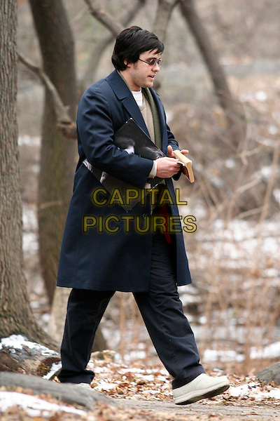 "JARED LETO.Playing Mark David Chapman, on the film set of ""Chapter 27"" filming across the street of the Dakota where John Lennon was shot New York, NY..January 17th, 2006.Ref: IW.full length blue coat walking.www.capitalpictures.com.sales@capitalpictures.com.©Capital Pictures"