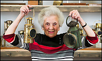 BNPS.co.uk (01202 558833)<br /> Pic: TomWren/BNPS<br /> <br /> Pamela Barnes with the collection of lamps.<br /> <br /> This is the 'Lady with the Lamp' whose impressive collection of 400 historic lamps has emerged for auction and is tipped to sell for &pound;10,000.<br /> <br /> Pamela Barnes and her husband Kenneth have amassed a remarkable haul of 19th and 20th century railway, naval and mining lamps.<br /> <br /> It all started 50 years ago when Mr Barnes, 90, gave up smoking and decided he needed another 'bad habit'. <br /> <br /> The couple picked up the lamps at second hand shops and would take them in their caravan to rallies across the south of England.