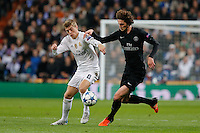 Real Madrid's German midfielder Tony Kroos and Paris Saint Germain Adrien Rabiot