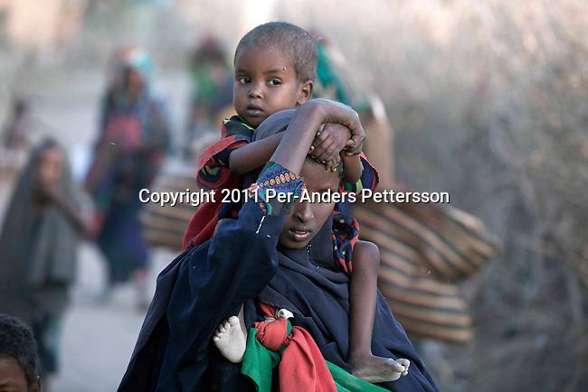 DADAAB, KENYA - JULY 31: Somali refugees arrive early in the morning outside the Dagaley refugee camp on July 31, 2011 in  Dadaab, Kenya. Hundreds of thousands of people have fled the hardship and civil war in Somalia to Dadaab. A severe drought has added to the misery and hardship. Some refugees has walked for up to thirty days to reach the camp, and some children died on the way, due to lack of food and water. (Photo by Per-Anders Pettersson)