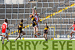 Aidan O'Mahony Rathmore punches the ball ahead of Johnny Buckley during the County Championship QF in Fitzgerald Stadium on Sunday