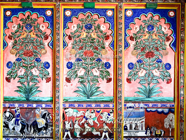 A decorative mural painted in vivid colors displaying flowers and old Indian scenes of wrestling and battle.<br /> (Photo by Matt Considine - Images of Asia Collection)