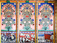 A decorative mural painted in vivid colors displaying flowers and old Indian scenes of wrestling and battle. (Photo by Matt Considine - Images of Asia Collection)