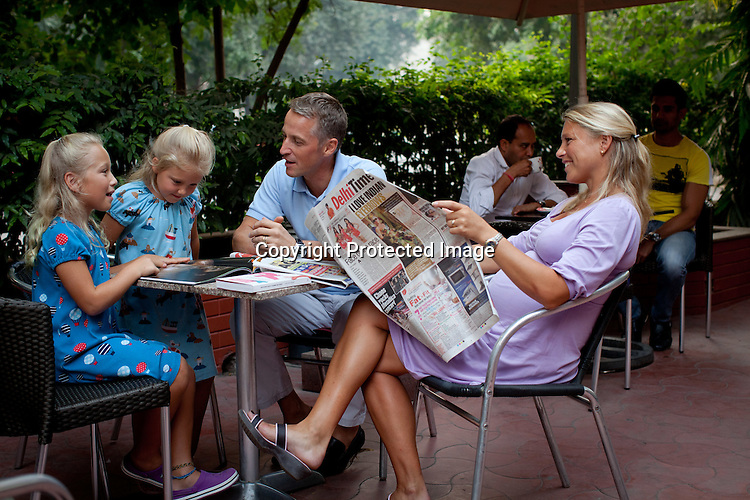 Magnus Oskarsson and his wife Cecilia Oskarsson seen with their two daughters, Iris and Siri in a cafe next to their home in New Delhi, India. Photo: Sanjit Das