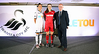 Pictured: Katy Hosford (RED) and Alicia Powe (WHITE) of the Swansea City FC Ladies' team model the home and away kits with Dsability Sport Wales representative. Monday 19 June 2017<br />Re: Swansea City FC launch their new home and away kits and announce Letou as their new sponsor at the Liberty Stadium, Swansea, Wales, UK.