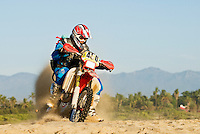 Male dirt bike rider along beach in Baja Mexico