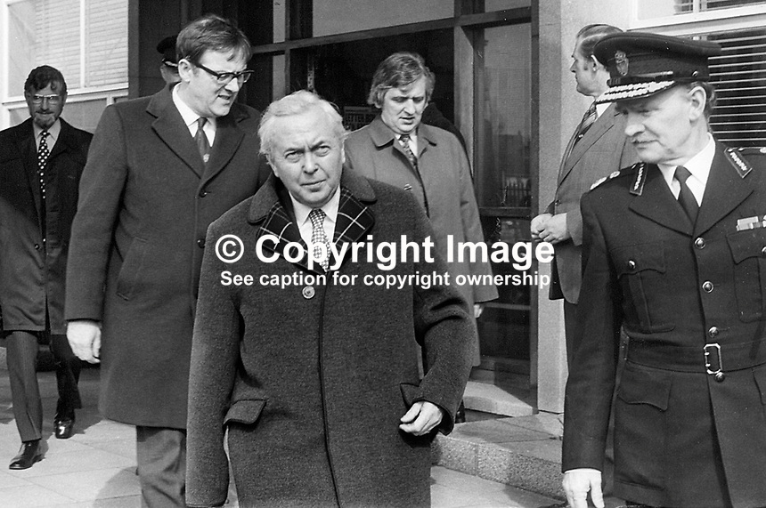 UK Prime Minister Harold Wilson at Castlereagh RUC Station during visit to Belfast, N Ireland. Also in picture are N Ireland Secretary of State, Merlyn Rees (left), and Sir Jamie Flanagan, Chief Constable of the RUC..NI Troubles. N Ireland Troubles. Ref: 197503030<br />