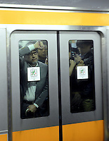 Businessmen looks through the window of a packed train in Shinjuku Station, Tokyo, Japan duringrush-hour. With up to 4 million passengers passing through it every day, Shinjuku station, Tokyo, Japan, is the busiest train station in the world. The station was used by an average of 3.64 million people per day.  That's 1.3 billion a year.  Or a fifth of humanity. Shinjuku has 36 platforms, and connects 12 different subway and railway lines.  Morning rush hour is pandemonium with all trains 200% full. <br /> <br /> Photo by Richard jones / sinopix