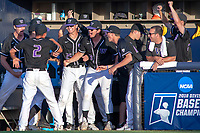 University of Washington Huskies celebrate a home run hit by Willie MacIver (9) against the Cal State Fullerton Titans at Goodwin Field on June 10, 2018 in Fullerton, California. The Huskies defeated the Titans 6-5. (Donn Parris/Four Seam Images)