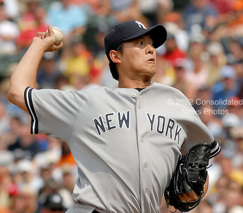 Baltimore, MD - July 29, 2007 -- New York Yankee pitcher Chien-Ming Wang (40) pitches in early action against the Baltimore Orioles at Oriole Park at Camden Yards in Baltimore, MD on Sunday, July 29, 2007.  Wang pitched six innings and gave up 3 runs to earn his 12th win.  The final score was Yankees 10 - Orioles 6..Credit: Ron Sachs / CNP.(RESTRICTION: No New York Metro or other Newspapers within a 75 mile radius of New York City)
