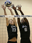 Marymount's Becca Schroeder and Morgan McAlpin block in a college volleyball game, in Arlington, Vir., on Saturday, Nov. 1, 2014.<br /> Photo by Cathleen Allison