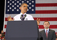 Oct 29, 2010. Virginia 5th District Representative Congressman Tom Perriello, right, watches as the President Barack Obama speaks during a campaign rally Friday at the Charlottesville Pavilion in downtown Charlottesville, Va. Photo/Andrew Shurtleff