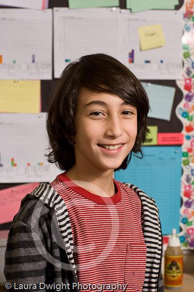 Elementary school Grade 5 closeup portrait of boy vertical