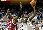 March 1, 2012: Nevada Wolf Pack forward Dario Hunt shoots over New Mexico State Aggies center Hamidu Rahman during their NCAA basketball game played at Lawlor Events Center on Thursday night in Reno, Nevada.