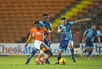 Bright Osayi-Samuel of Blackpool struggles with Anthony Stewart (centre) & Luke O'Nien of Wycombe Wanderers during the The Checkatrade Trophy match between Blackpool and Wycombe Wanderers at Bloomfield Road, Blackpool, England on 10 January 2017. Photo by Andy Rowland / PRiME Media Images.