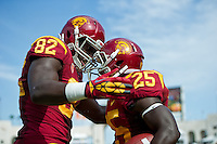 LOS ANGELES, CA - September 22, 2012: Tight end Randall Telfer (82) congratulates running back Silas Redd (25) on his touchdown during the USC Trojans vs the Cal Bears at the Los Angeles Memorial Coliseum in Los Angeles, CA. Final score USC 27, Cal 9..