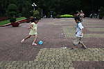 Two children play with a ball in the 23/9 park in Ho Chi Minh City, Vietnam. Aug. 23, 2011.
