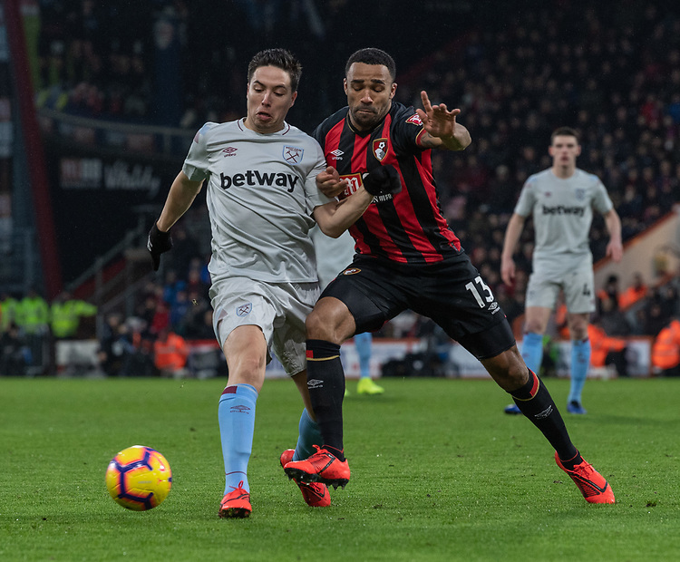 Bournemouth's Callum Wilson (right) battles with West Ham United's Samir Nasri (left) <br /> <br /> Photographer David Horton/CameraSport<br /> <br /> The Premier League - Bournemouth v West Ham United - Saturday 19 January 2019 - Vitality Stadium - Bournemouth<br /> <br /> World Copyright &copy; 2019 CameraSport. All rights reserved. 43 Linden Ave. Countesthorpe. Leicester. England. LE8 5PG - Tel: +44 (0) 116 277 4147 - admin@camerasport.com - www.camerasport.com