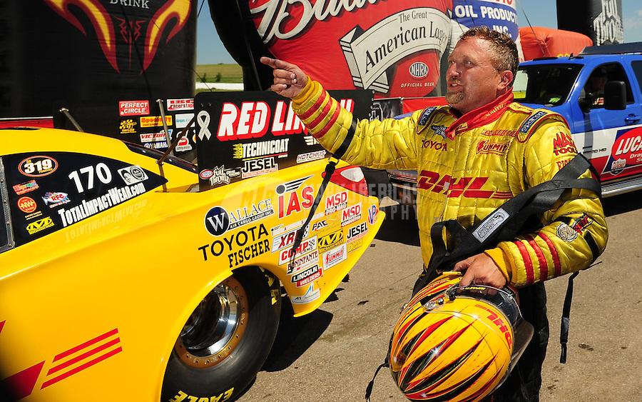 May 30, 2009; Topeka, KS, USA: NHRA funny car driver Jeff Arend during qualifying for the Summer Nationals at Heartland Park Topeka. Mandatory Credit: Mark J. Rebilas-