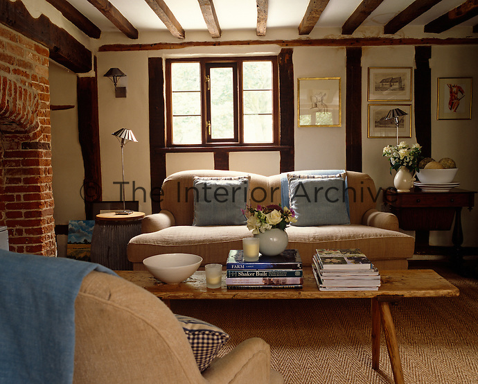 In a restored Norfolk cottage a contemporary look is achieved using natural flooring and simple furniture