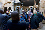 Africans Christian pilgrims visit the Church of the Nativity, revered as the site of Jesus Christ's birth, on December 22, 2016 in the biblical West Bank town of Bethlehem. Photo by Wisam Hashlamoun