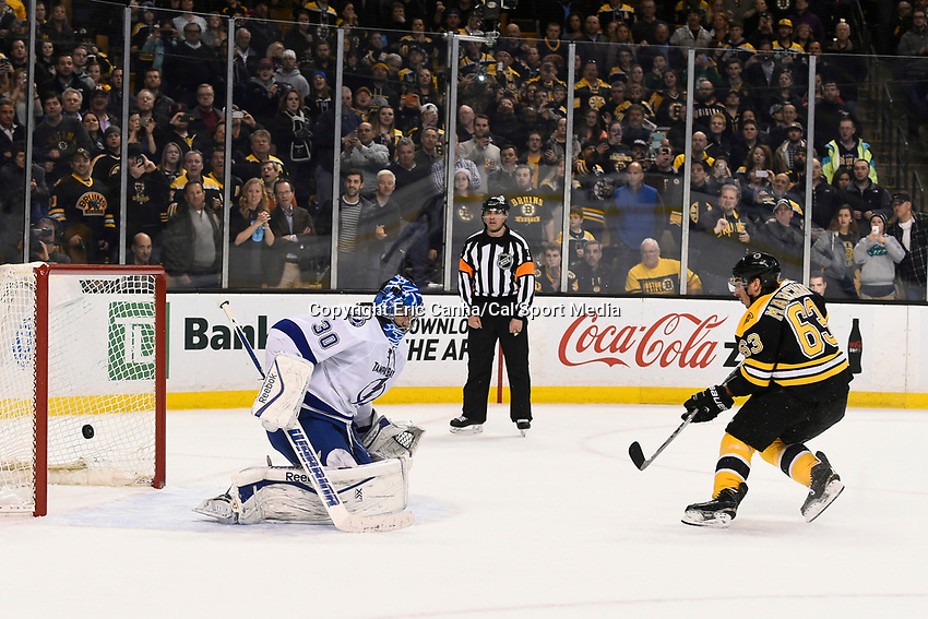 March 12, 2015 - Boston, Massachusetts, U.S. - Boston Bruins left wing Brad Marchand (63) scores the game winning goal against Tampa Bay Lightning goalie Ben Bishop (30) in an   overtime shoot out during the NHL match between the Tampa Bay Lightning and the Boston Bruins held at TD Garden in Boston Massachusetts. The Bruins defeated the Lightning 3-2 in overtime. Eric Canha/CSM