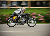10th September 2017, Goodwood Estate, Chichester, England; Goodwood Revival Race Meeting; A BMWRS54 vintage bike ridden by Maria Costello races through the Goodwood straight