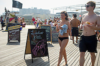 Concession stand on the boardwalk at Rockaway Beach in the Queens borough of New York on Saturday, June 30, 2012 during the long Fourth of July weekend.  (© Frances M. Roberts)