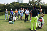 Sam Brazel of Australia (yellow trousers) teaches amateur golfers during a clinic on the side of UBS Hong Kong Open golf tournament at the Fanling golf course on 23 October 2015 in Hong Kong, China. Photo by Xaume Olleros / Power Sport Images