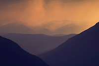 Mountains at sunset with rainfront, Glacier National Park, Montana, USA