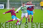 Listowel Celtic's Pa Walsh and Spa Road FC's Anthony Morrison.