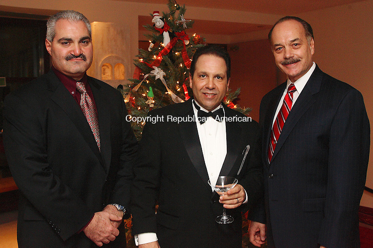 "WATERBURY, CT  DECEMBER 2006-120106MK32  (from left) Tony Pelugo, Don Piambo and Joe Swaniger gathered at the Matattuck Museum Arts and History Center Friday evening. The annual Festival of Trees wrapped up in a Gala which featured ""Silver Bells in the City"" as its theme paying homage to the sights and sounds of Hollywood. Michael Kabelka / Republican-American ((from left) Tony Pelugo, Don Piambo and Joe SwanigerCQ)"