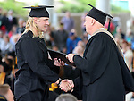Interim President Chester Burton congratulates Rayne Raven during the Western Nevada College commencement at the Pony Express Pavilion, in Carson City, Nev., on Monday, May 19, 2014. <br /> Photo by Cathleen Allison/Nevada Photo Source