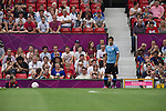 Uruguay 2 United Arab Emirates 1, Great Britain 1 Senegal 1, 26/07/2012. Old Trafford, Olympic Games. Uruguay captain Luis Suarez prepares to take a free-kick at Manchester United's Old Trafford stadium during the first half of his team's opening match at the Men's Olympic Football tournament. The double header of games resulted in Uruguay defeating the United Arab Emirates by 2-1 while Great Britain and Senegal drew 1-1. Over 72,000 spectators attended the two Group A matches. Photo by Colin McPherson.