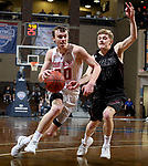SIOUX FALLS, SD - MARCH 10:  Grant Smith #30 from Indiana Wesleyan drives against Andrew Semadeni #14 from Morningside during their quarterfinal game at the 2018 NAIA DII Men's Basketball Championship at the Sanford Pentagon in Sioux Falls. (Photo by Dave Eggen/Inertia)