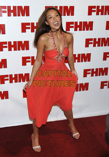 MYLEENE KLASS.FHM 100 Sexiest Women in the World 2005,.Umbaba, Kingly Court, London, .April 21st 2005..full length red orange dress beaded halterneck pleated cut out funny face.Ref: PL.www.capitalpictures.com.sales@capitalpictures.com.©Capital Pictures