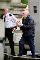 Pictured: Keith Morgan (R) arrives at Cardiff Crown Court where he was sentencing. Monday 15 October 2018<br /> Re: Conman Keith Morgan has been jailed for 8 and a half years at Cardiff Crown Court. He had claimed that he was one of the world's wealthiest men but instead he was living on benefits in rented accommodation in Pontypridd.