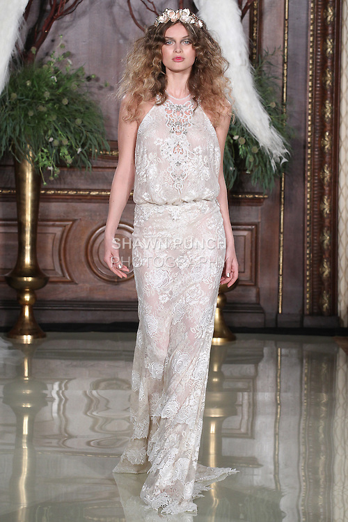 """Model walks runway in a Savannah wedding gown from the Galia Lahav Haute Couture """"Les Reves Bohemiens"""" collection, during New York Bridal Fashion Week Spring 2016."""