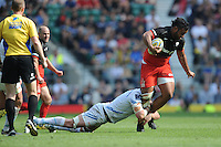 Billy Vunipola of Saracens is tackled during the Aviva Premiership Rugby Final between Saracens and Exeter Chiefs at Twickenham Stadium on Saturday 28th May 2016 (Photo: Rob Munro/Stewart Communications)