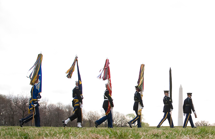 The Armed Forces Color Guard arrives for the ceremony marking the 25th Anniversary of the Groundbreaking of the Vietnam Veterans Memorial in Washington on March 26, 2007.