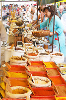 Spice seller at a market. Customers. Collioure. Roussillon. France. Europe.