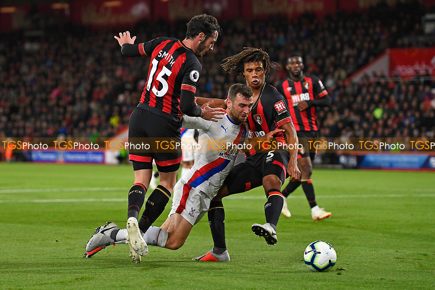 Max Meyer of Crystal Palace goes down under pressure from Adam Smith of AFC Bournemouth and Nathan Ake of AFC Bournemouth during AFC Bournemouth vs Crystal Palace, Premier League Football at the Vitality Stadium on 1st October 2018