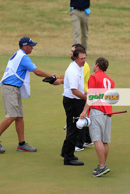 Phil MICKELSON (USA) holes his putt for birdie at the 18th for a score of 3 under par during round 4 of  The 142th Open Championship Muirfield, Gullane, East Lothian, Scotland 21/7/2013<br /> Picture Eoin Clarke www.golffile.ie: