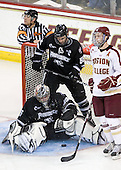 John Gravallese, Alex Beaudry (PC - 35), Daniel New (PC - 55), Paul Carey (BC - 22) - The Boston College Eagles defeated the visiting Providence College Friars 4-1 (EN) on Tuesday, December 6, 2011, at Kelley Rink in Conte Forum in Chestnut Hill, Massachusetts.