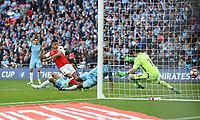 Arsenal's Alexis Sanchez scores his sides second goal <br /> <br /> Photographer Rob Newell/CameraSport<br /> <br /> The Emirates FA Cup Semi-Final - Arsenal v Manchester City - Sunday 23rd April 2017 - Wembley Stadium - London<br />  <br /> World Copyright &copy; 2017 CameraSport. All rights reserved. 43 Linden Ave. Countesthorpe. Leicester. England. LE8 5PG - Tel: +44 (0) 116 277 4147 - admin@camerasport.com - www.camerasport.com
